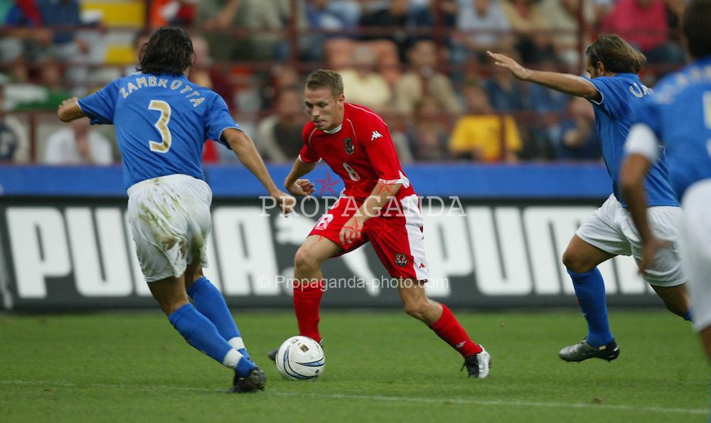 MILAN, ITALY - Saturday, September 6, 2003: Wales' Craig Bellamy takes on Italy's Gianluca Zambrotta during the Euro 2004 qualifying match at the San Siro Stadium. (Pic by David Rawcliffe/Propaganda)
