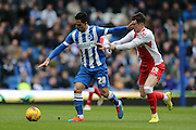 Beram Kayal, Brighton midfielder holds off Rob Kiernan during the Sky Bet Championship match between Brighton and Hove Albion and Birmingham City at the American Express Community Stadium, Brighton and Hove, England on 21 February 2015.