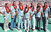 (L-R) Former players Miami Dolphins quarterback Bob Griese, Oakland / Los Angeles Raiders linebacker Ted Hendricks, San Francisco 49ers tackle Bob St. Clair, Dallas Cowboys head coach Tom Landry, Pittsburgh Steelers linebacker Jack Lambert, Pittsburgh Steelers  running back Franco Harris, and Kansas City Chiefs defensive tackle Buck Buchanan pose for a photo after being recently announced members of the latest Pro Football Hall of Fame class of 1990 at halftime during the 1990 NFL Pro Bowl between the National Football Conference and the American Football Conference on Feb. 4, 1990 in Honolulu. The NFC won the game 27-21. (©Paul Anthony Spinelli)