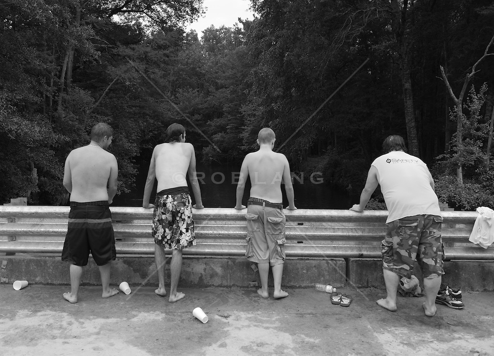 Four men looking at a pond in South Carolina
