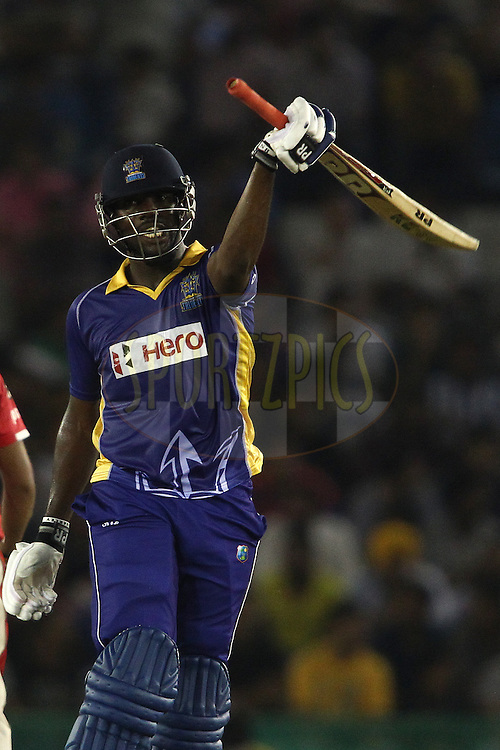 Raymon Reifer of the Barbados Tridents celebrates reaching his fifty during match 5 of the Oppo Champions League Twenty20 between the Kings XI Punjab and the Barbados Tridents held at the Punjab Cricket Association Stadium, Mohali, India on the 20th September 2014<br /> <br /> Photo by:  Shaun Roy / Sportzpics/ CLT20<br /> <br /> <br /> Image use is subject to the terms and conditions as laid out by the BCCI/ CLT20.  The terms and conditions can be downloaded here:<br /> <br /> http://sportzpics.photoshelter.com/gallery/CLT20-Image-Terms-and-Conditions-2014/G0000IfNJn535VPU/C0000QhhKadWcjYs
