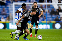 George Evans of Derby County takes on Terence Kongolo of Huddersfield Town - Mandatory by-line: Robbie Stephenson/JMP - 05/08/2019 - FOOTBALL - The John Smith's Stadium - Huddersfield, England - Huddersfield Town v Derby County - Sky Bet Championship