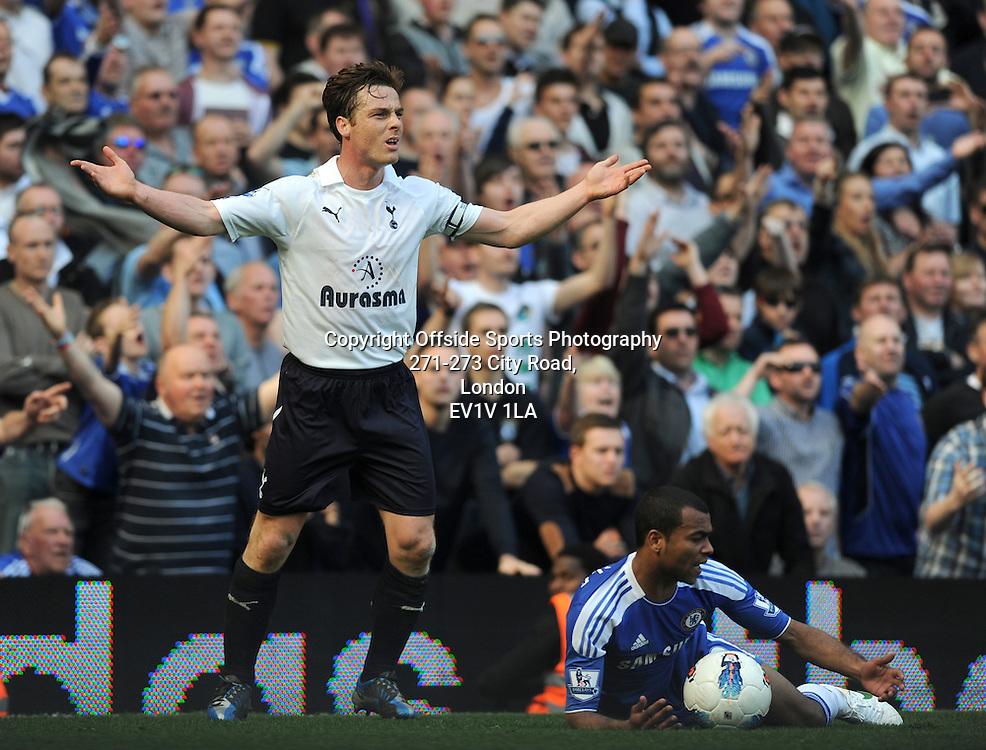 24/03/2012 - Barclays Premier League Football - 2011-2012 - Chelsea v Tottenham Hotspur - Ashley Cole of Chelsea goes down under pressure from Scott Parker of Spurs. - Photo: Charlie Crowhurst / Offside.