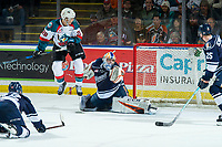 KELOWNA, CANADA - FEBRUARY 2: Leif Mattson #28 of the Kelowna Rockets jumps in the air as Dylan Ferguson #31 of the Kamloops Blazers misses an OT save on February 2, 2019 at Prospera Place in Kelowna, British Columbia, Canada.  (Photo by Marissa Baecker/Shoot the Breeze)