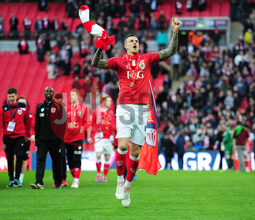 Bristol City's Aden Flint celebrates at full time. - Photo mandatory by-line: Alex James/JMP - Mobile: 07966 386802 - 22/03/2015 - SPORT - Football - London - Wembley Stadium - Bristol City v Walsall - Johnstone Paint Trophy Final