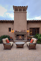 Outdoor furniture on patio of luxury home.