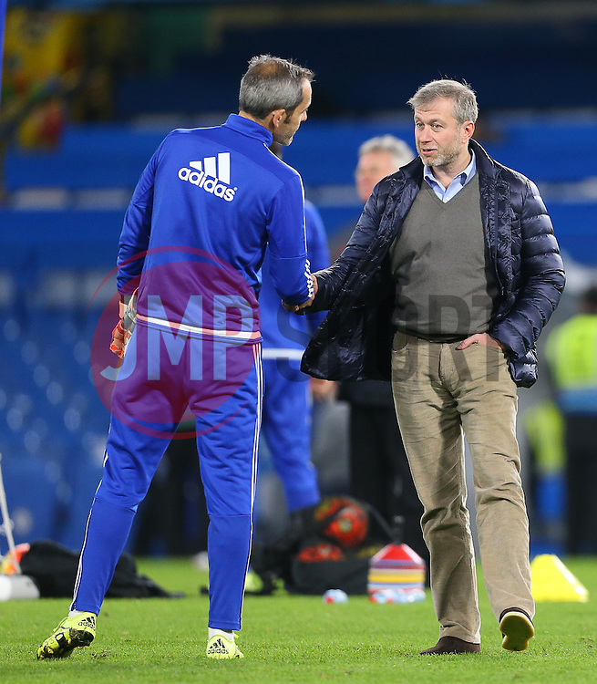 Chelsea owner, Roman Abramovich ( R ) shakes hands with Christophe Lollichon, Chelsea goalkeeper coach  - Mandatory byline: Paul Terry/JMP - 07966 386802 - 19/12/2015 - FOOTBALL - Stamford Bridge - London, England - Chelsea v Sunderland - Barclays Premier League