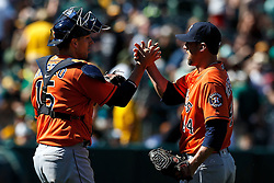 OAKLAND, CA - MAY 01: Luke Gregerson #44 of the Houston Astros celebrates with Jason Castro #15 after the game against the Oakland Athletics at the Oakland Coliseum on May 1, 2016 in Oakland, California. The Houston Astros defeated the Oakland Athletics 2-1. (Photo by Jason O. Watson/Getty Images) *** Local Caption *** Luke Gregerson; Jason Castro
