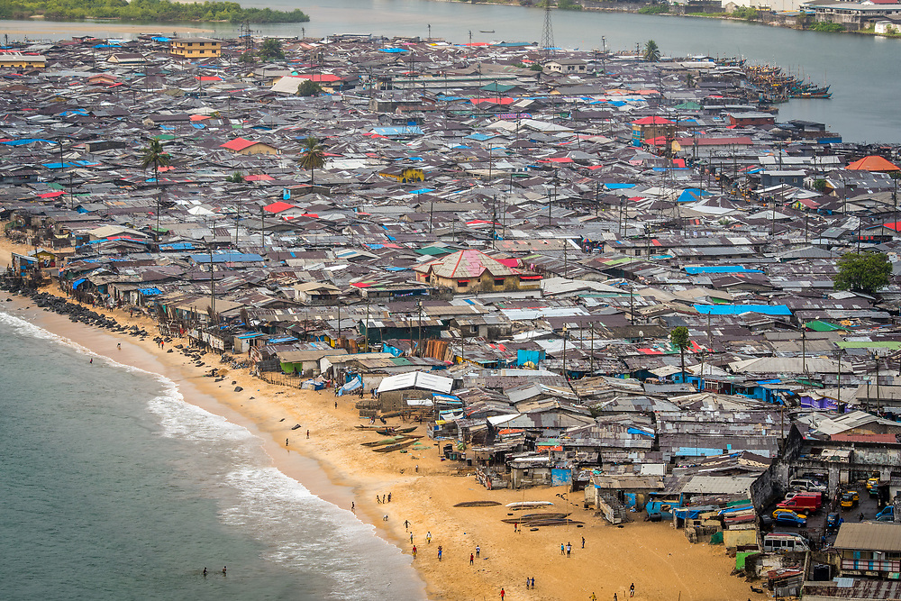 An elevated view of the slums and the beach in the city of Monrovia, Liberia.