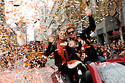 Giants pitcher Matt Cain, wife Chelsea and daughter Hartley wave during the World Series victory parade on Wednesday, October 31, 2012 in San Francisco, Calif.