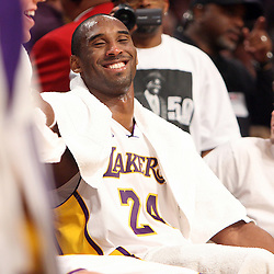 Laker's Kobe Bryant ,24, smiles as filmmaker Spike Lee films him for a story during a basketball game between the San Antonio Spurs and the Los Angeles Lakers April 13. 2008 at the Staples Center.  (SGVN/Staff Photo Keith Birmingham/SXSports)