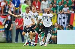 MOSCOW, RUSSIA - Sunday, June 17, 2018: Germany's Thomas Mueller (left) and Jerome Boateng (right) tackle Mexico's Hector Herrera during the FIFA World Cup Russia 2018 Group F match between Germany and Mexico at the Luzhniki Stadium. (Pic by David Rawcliffe/Propaganda)