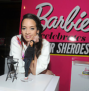 "Dascha Polanco, of Orange is the New Black, admires the Ava DuVernay one-of-a-kind Barbie at the Variety Power of Women event, Friday, April 24, 2015, in New York, where Ava was honored as a Barbie ""Shero.""  Ava DuVernay, along with Emmy Rossum, Eva Chen, Kristin Chenoweth, Sydney ""Mayhem"" Keiser, and Trisha Yearwood, are the first ever Barbie Sheroes, which celebrates women who are inspiring girls.  (Photo by Diane Bondareff/Invision for Barbie/AP Images)"