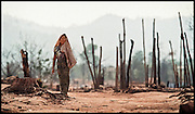 Burma, Thailand tab: Burmese refugee woman  : A LAND OF WAR : A JOURNEY OF THE HEART :   BURMESE GOVERNMENT TROOPS HAVE CROSSED THE BORDER INTO THAILAND SEVERAL TIMES TO BURN THE BAMBOO SHELTERS IN THIS REFUGEE CAMP, POPULATED MOSTLY WITH WOMEN AND CHILDREN. POSTS FOR NEW SHELTERS RISE FROM HOLES DUG WITH TIN CANS. ( 2 OF 19 )<br /> <br /> Dr. Cynthia Maung
