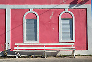Empty bench outside the Customs House, Bimini along the King's Highway in Alice Town on the tiny Caribbean island of Bimini, Bahamas