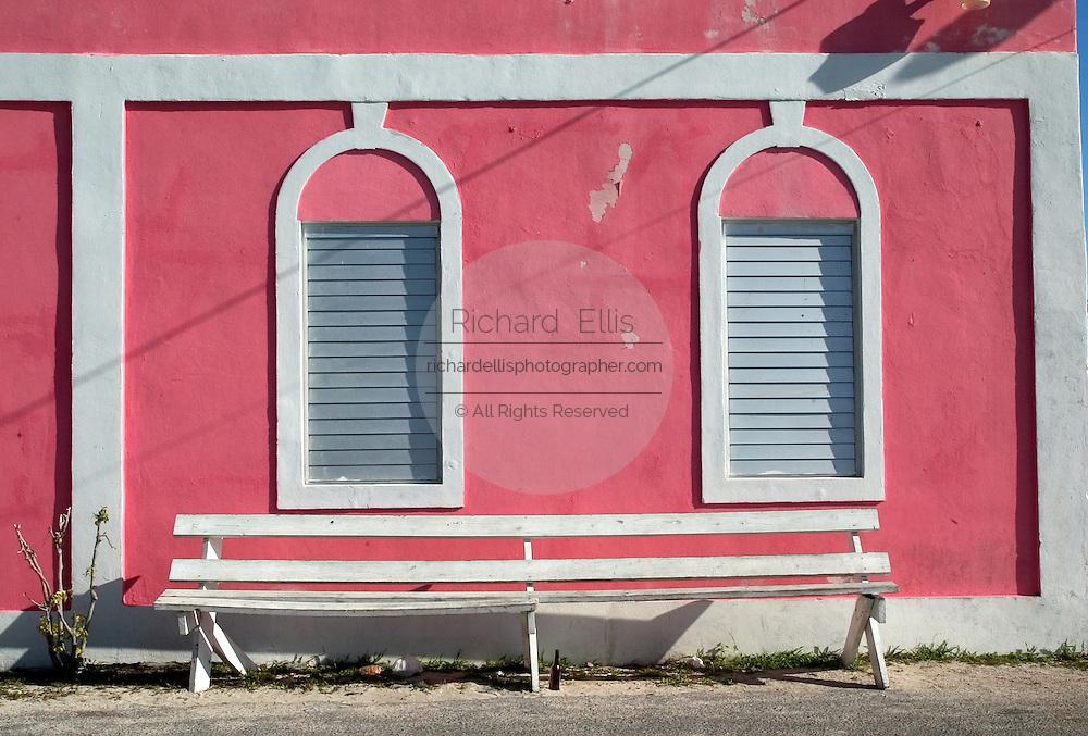 Empty bench outside the Customs House, Bimini along the King's Highway in Alice Town on the tiny Caribbean island of Bimini, Bahamas
