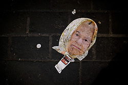 © licensed to London News Pictures. London, UK 01/01/2015. A mask of the Queen Elizabeth II left by revellers in central London celebrating the New Year at the first hours of 2015. Photo credit: Tolga Akmen/LNP