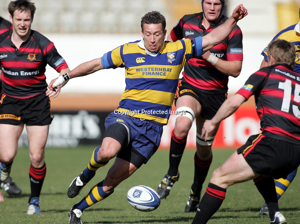 Adrian Cashmore looks to kick through for BOP during the NPC First Division, Ranfurly Shield clash between the Bay Of Plenty Steamers and Canterbury at Blue Chip Stadium, Tauranga, Sunday September 05, 2004. Canterbury won the match, 33 - 26, to secure the shield.<br />PHOTO: Hannah Johnston/PHTOSPORT