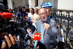 © Licensed to London News Pictures. 10/07/2017. London, UK. Reverend Patrick Mahoney and pro-Charlie Gard supporters wait for Connie Yates and Chris Gard to arrive at The High Court in London on 10 July 2017. The parents of terminally ill Charlie Gard have returned to the High Court in light of new evidence relating to potential treatment for their son's condition. An earlier lengthy legal battle ruled that Charlie could not be taken to the US for experimental treatment. London, UK. Photo credit: Tolga Akmen/LNP