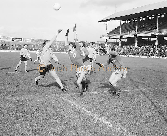 Players stretch to catch the ball near the goal mouth during the Antrim v Mayo All Ireland Minor Gaelic Football Final in Croke Park on the 8th of September 1974.