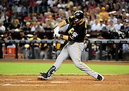 Sep. 20 2011; Phoenix, AZ, USA; Pittsburgh Pirates catcher Ryan Doumit (41) doubles to right field during the fifth inning against the Arizona Diamondbacks at Chase Field.  Mandatory Credit: Jennifer Stewart-US PRESSWIRE..