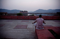 A man prays along a walk way near the water palace, in the early morning in Jaipur City india Nov. 16, 2006 Jaipur India.    (photo by Darren Hauck)......