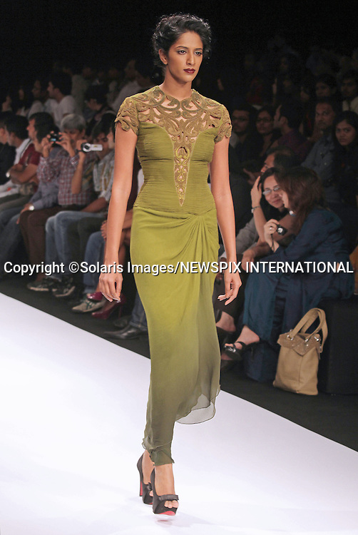 """Mumbai, India-06/03/2012: LAKME FASHION WEEK.Creation from designer Kartikeya and Isha at the LFW Summer/Resort 2012 fashion collection, during Lakme Fashion Week 2012 in Mumbai, India..Mandatory Photo Credit: ©Ramesh Nair-Solaris Images/NEWSPIX INTERNATIONAL..**ALL FEES PAYABLE TO: """"NEWSPIX INTERNATIONAL""""**..PHOTO CREDIT MANDATORY!!: NEWSPIX INTERNATIONAL(Failure to credit will incur a surcharge of 100% of reproduction fees)..IMMEDIATE CONFIRMATION OF USAGE REQUIRED:.Newspix International, 31 Chinnery Hill, Bishop's Stortford, ENGLAND CM23 3PS.Tel:+441279 324672  ; Fax: +441279656877.Mobile:  0777568 1153.e-mail: info@newspixinternational.co.uk"""