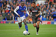 Ipswich Town defender Aristote Nsiala (22)  and Bolton Wanderers forward Josh Magennis (28) during the EFL Sky Bet Championship match between Ipswich Town and Bolton Wanderers at Portman Road, Ipswich, England on 22 September 2018.
