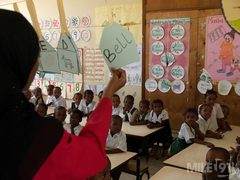 Teacher Asya Hassan Mussa is teaching a class full of primary school children at Saateni nursery school, Zanzibar, Tanzania. Teacher Asya was taught by VSO volunteer teacher trainer, Daphne Sharp. Daphne has now trained over 100 nusery school teachers and 18 heads of pre school.