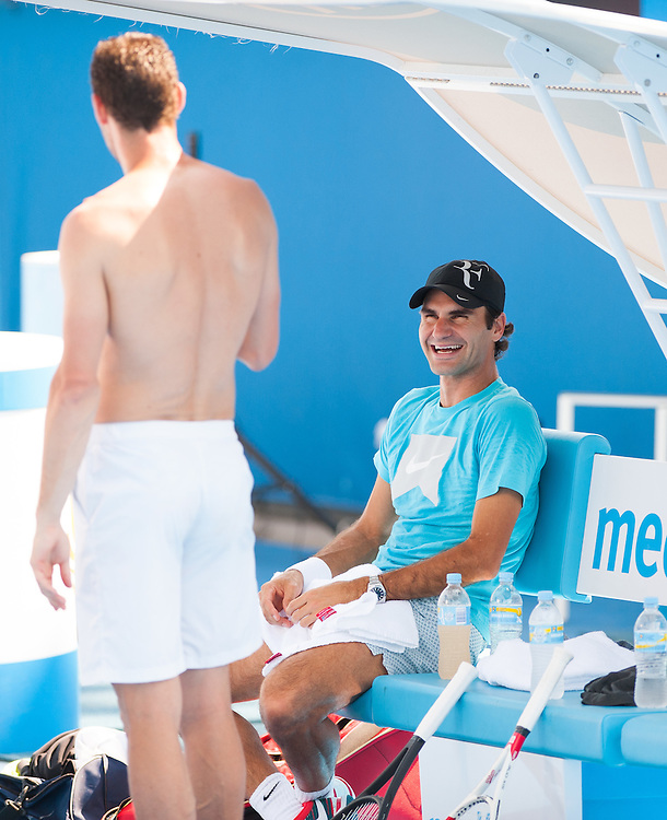 Roger Federer of Switzerland can almost take a day off as he awaits the semifinals in the 2014 Australian Open - but he still gets in a little hitting practice and a few laughs with a training partner in Melbourne's Olympic Park.