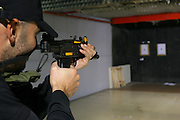 Man in a firing range practice
