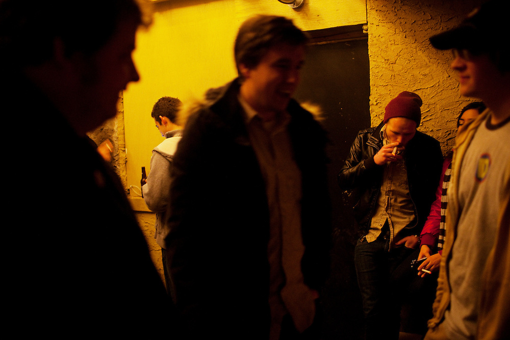 Bar-goers smoke cigarettes outside of The Village Idiot in Columbus, Ohio on Friday, February 25, 2011. Senate Bill 5 would eliminate collective bargaining rights for state workers, which Governor John Kasich claims is a necessary reaction to the budget crisis.