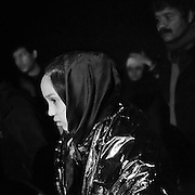 Greece, Chios, The Odyssey. It Does Not Ends Here 2<br /> Through The Night Refugees a few minutes after arriving at the coast in Chios, near Karfaz. They came from Cesme, Turkey with a dinghy and with fake life jackets at night. Depending on the sea, it takes them between three to five hours to cross the Aegean Sea between Turkey and Greece, depending where they start, its about minimum 8 nautical miles between coast to coast. Refugees from Afghanistan, Iran, Syria and other countries form the near east, made it to Greece by crossing the Aegean Sea with a rubber dinghy.
