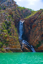 Water cascades down Turtle Falls,  in Dugong Bay on the Kimberley coast at the end of the wet season.