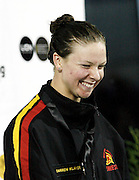 Lauren Boyle accepting gold after winning the Womans 400m Freestyle A Final on day one of the 2006 New Zealand Youth and Open Swimming Championships at QEII Leisure Centre, Christchurch on Wednesday 12 April 2006. Photo: Simon Fergusson/PHOTOSPORT<br /> <br /> <br /> 120406
