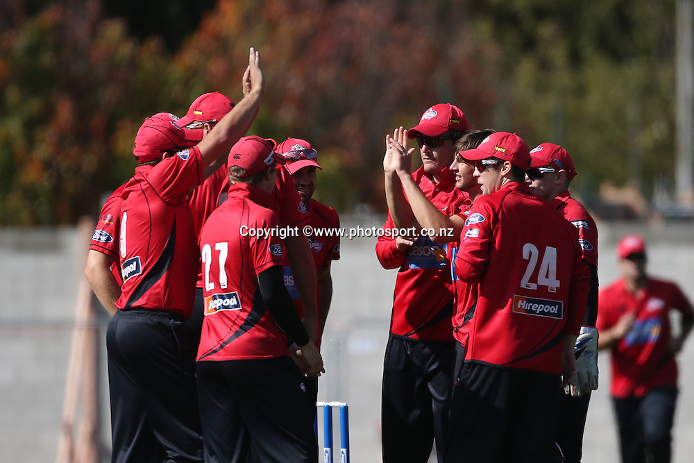 Ryan McCone of the Wizards celebrates with team mates after a wicket during the Ford Trophy cricket match between the Canterbury Wizards v Northern Knights at Hagley Oval, Christchurch. 26 March 2014 Photo: Joseph Johnson/www.photosport.co.nz