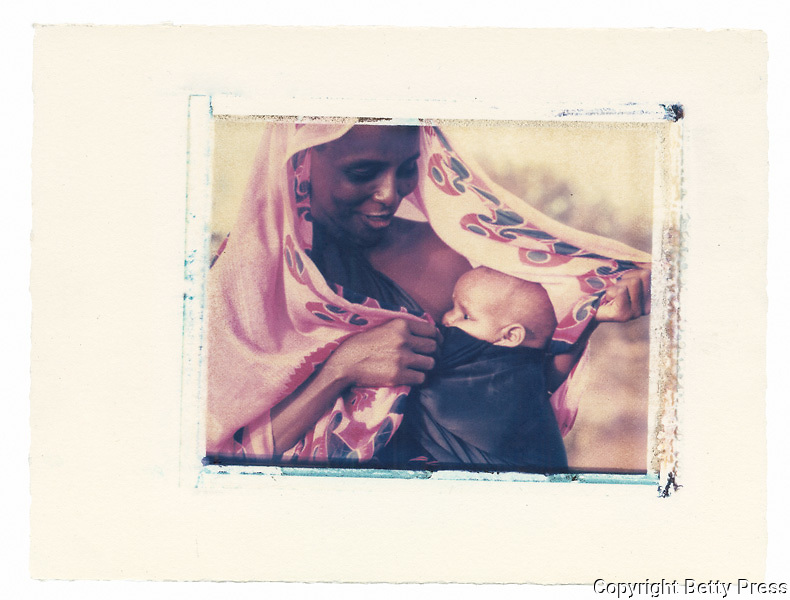 Somali mother protects her child in the desert  Refugee Camp, Kenya<br />