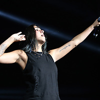 "Yasmine Yousaf of the band Krewella performs in front of the ""Light Volcano"", during the Verge Campus Spring Tour concert at the CFE Arena on the University of Central Florida campus, Tuesday, April 8, 2014, in Orlando, Florida.  (AP Photo/Alex Menendez)"
