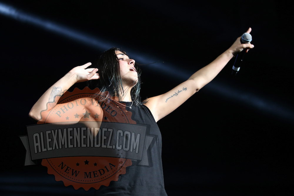 """Yasmine Yousaf of the band Krewella performs in front of the """"Light Volcano"""", during the Verge Campus Spring Tour concert at the CFE Arena on the University of Central Florida campus, Tuesday, April 8, 2014, in Orlando, Florida.  (AP Photo/Alex Menendez)"""