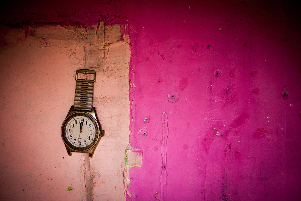 "A watch in the flat of  Milena and their family at the concrete building ""Hrebenova 34-36"" which was in an appalling condition and demolished in August 2014 by the city of Kosice. The family of Milena, her mother Bozena and their children had been one of the last families living in that building waiting for a compensatory flat which they received a short while later. They belonged among the 5% of inhabitants of that building which had a renting contract, were paying rent and with that the right to get a new flat at the housing estate."