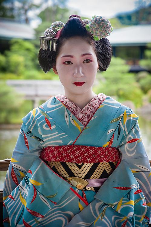 Geisha visiting Heian Shrine Garden in Kyoto (Japan).