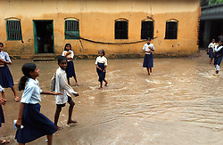 PATNA,INDIA, AUGUST 12: Indian children leave school after monsoon rains flooded their classrooms in a village about 100 kilometers from Patna in the state of Bihar, India August 12, 2003. Bihar is the poorest state in India and the monsoon rains have brought severe flooding. There have been 333 deaths in India, 181 in Bangladesh, 112 in Nepal, and 168 in Pakistan and millions are homeless across the subcontinent. .(Photo by Ami Vitale/Getty Images)