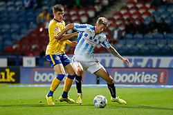 Jonathan Stead of Huddersfield is challenged by Rob Kiernan of Wigan - Photo mandatory by-line: Rogan Thomson/JMP - 07966 386802 - 16/09/2014 - SPORT - FOOTBALL - Huddersfield, England - The John Smith's Stadium - Huddersfield Town v Wigan Athletic - Sky Bet Championship.