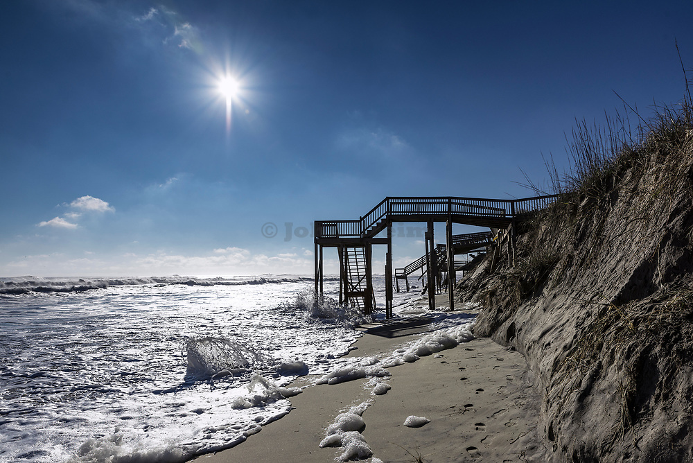 Beach steps surrounded by high tide surf, Nags Head, Outer Banks, North Carolina, USA