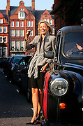 UK ENGLAND LONDON 16OCT06 - Nadja Swarovski (35) poses for a portrait in a black cab in central London. Swarovski is one of the heirs to the Swarovski family business, one that turns over £ 1.0 billion each year and has a virtual monopoly on crystal and related products, and is developing a reputation as one of the great patrons of contemporary design.<br />