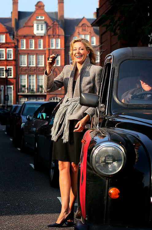 UK ENGLAND LONDON 16OCT06 - Nadja Swarovski (35) poses for a portrait in a black cab in central London. Swarovski is one of the heirs to the Swarovski family business, one that turns over £ 1.0 billion each year and has a virtual monopoly on crystal and related products, and is developing a reputation as one of the great patrons of contemporary design.<br /> Photography by Jiri Rezac<br /> Tel 0044 07947 884 517<br /> www.linkphotographers.com