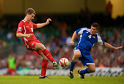 CARDIFF, WALES - Saturday, October 11, 2008: Wales' Sam Vokes and Liechtenstein's Fabio D'Elia during the 2010 FIFA World Cup South Africa Qualifying Group 4 match at the Millennium Stadium. (Photo by David Rawcliffe/Propaganda)