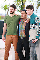 Nikos Gelia, director Panos Koutras and Kostas Nikouli at the photo call for the film Xenia at the 67th Cannes Film Festival, Monday 19th May 2014, Cannes, France.