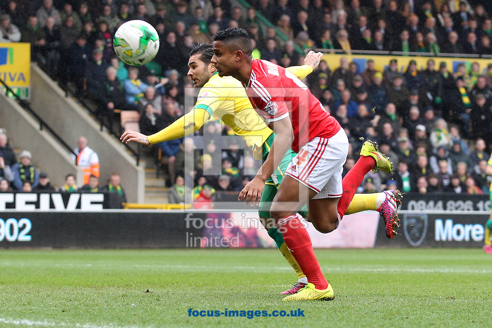 Michael Mancienne of Nottingham Forest and Bradley Johnson of Norwich in action during the Sky Bet Championship match at Carrow Road, Norwich<br /> Picture by Paul Chesterton/Focus Images Ltd +44 7904 640267<br /> 21/03/2015