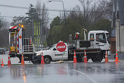 Road traffic management on Opawa Road after flooding from the Heathcote River, Christchurch, New Zealand, Saturday, July 22, 2017. Credit:  SNPA / David Alexander -NO ARCHIVING-